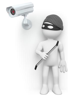 Karikatur Kamera und Einbrecher